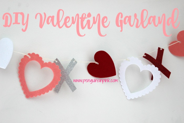 DIY Valentine Garland - Die cut hearts in red, white, and pink and glittery X's make a festive and easy DIY Valentine Garland. #ValentinesDay #DIY