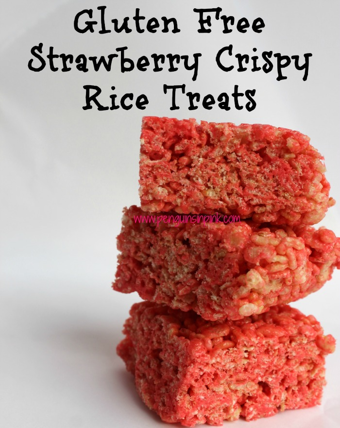 Gluten Free Strawberry Crispy Rice Treats 4 common pantry staples combine to make a pretty in pink strawberry flavored twist on a classic treat. #glutenfree #crispyricetreats #easy #kidsinthekitchen