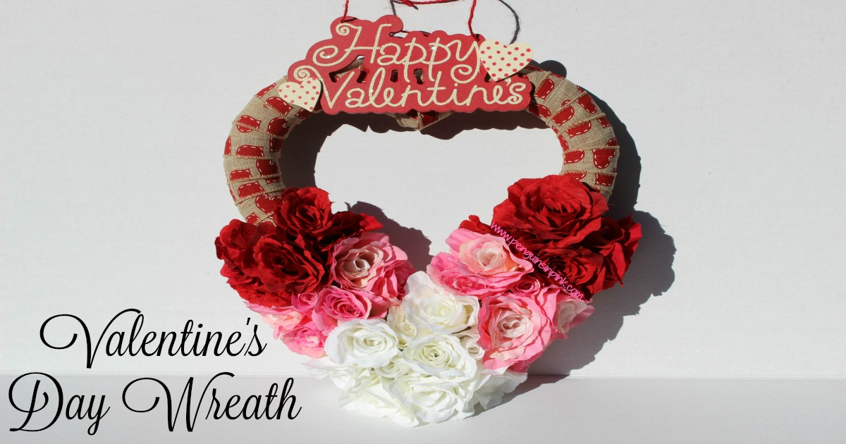 Valentine's Day Wreath - A fun craft making a festive Valentine's day wreath using a heart shaped wreath, burlap ribbon, and three different colored roses to give it an ombre look.