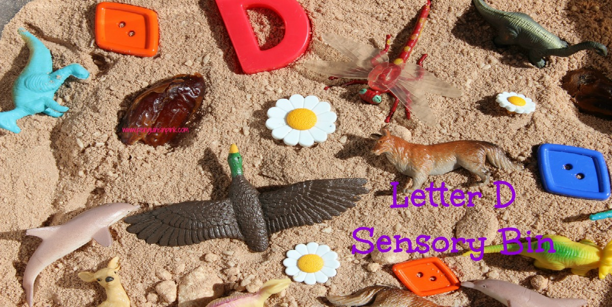 "Letter D Sensory Bin - A fun sensory bin filled with edible dirt, dogs, dinosaurs, dolphins, dragonflies, and other items beginning with letter ""D""."