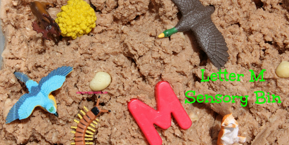 """Letter M Sensory Bin - This edible mud based sensory bin has it all monkeys, macaws, moose, and other items beginning with letter """"M""""."""