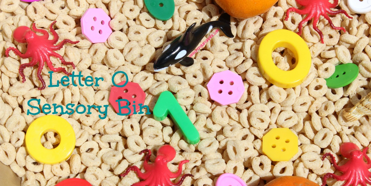 "Letter O Sensory Bin - This O shaped cereal based sensory bin has it all ovals, owls, octopi and other items beginning with letter ""O""."