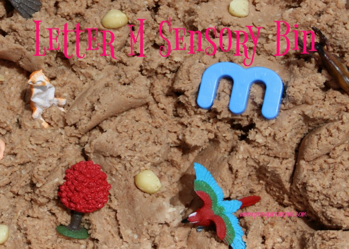 "Letter M Sensory Bin - This edible mud based sensory bin has it all monkeys, macaws, moose, and other items beginning with letter ""M""."