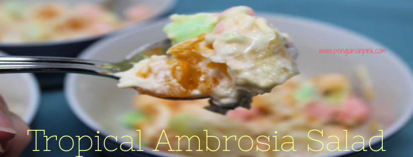 Tropical Ambrosia Salad is a cool, sweet treat made with mango, pineapple, and orange pieces mixed with yogurt, coconut flakes, and mini marshmallows.