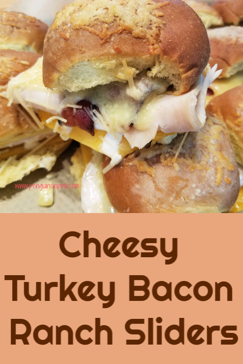 Cheesy Turkey Bacon Ranch Sliders are full of crispy bacon, juicy turkey, two kinds of cheddar cheese topped with ranch dressing sandwiched between potato rolls.